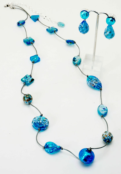 "#22419<br>Blown glass, Venetian glass <br>and metallic silver leather.<br>Silver plated clasp and 4"" extender chain.<br>32.5"" to 36.5"" Limited Edition.<br>Necklace 125.00<br>Earrings with Venetian glass ear posts $42.00"