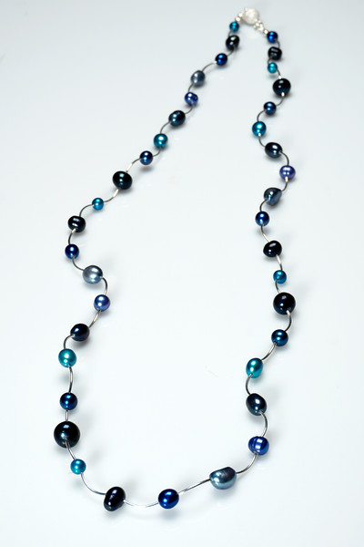 "#13519<br>Multi-blue pearls and <br>Silver plated tubes. <br>Magnetic clasp.<br>37"" or doubled @18"" Limited Edition.<br>$135.00"