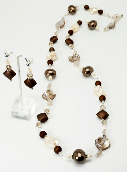 "#16517<br>Shell pearl, rubber, shell, rutile quartz and pearls.<br> Magnetic clasp. <br>Necklace 36"" or doubled at 18"" Limited Edition $135.00<br>Earrings with silver plated ear posts $25.00"