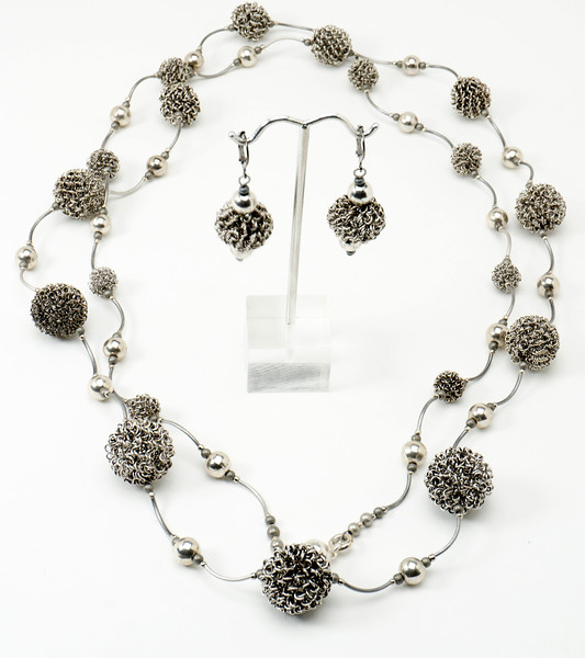 "#28316 <br>Steel wrapped wire, pewter and gunmetal tubes. <br>Magnetic clasp. 40""<br>Necklace Limited Edition.$175.00<br>Earrings with silver plated French clips $27.00"