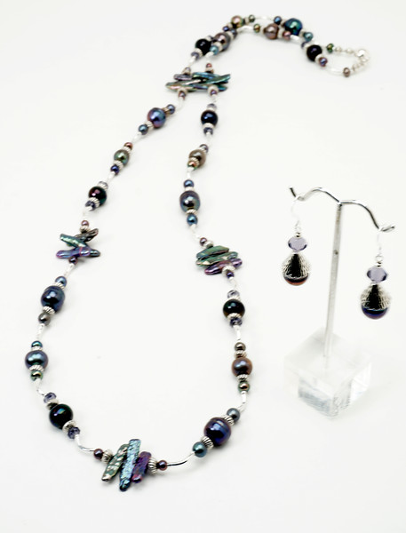 "#209187<br>Peacock pearls, amethyst,pewter<br>And silver plated tubes.<br>Magnetic clasp.<br>Wear long at 37"" or doubled at 18""<br>Limited Edition.<br>Necklace $150.00<br>Earrings $28.00"