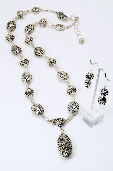 "#20014 <br>Pewter open-cut beads and tubes <br>Extra large, fancy lobster clasp and <br>heavy 3.5"" silver plated extender chain. <br>Necklace 28.5"" to 32"" Limited Edition $95.00<br>Earrings with silver ear wires $30.00"
