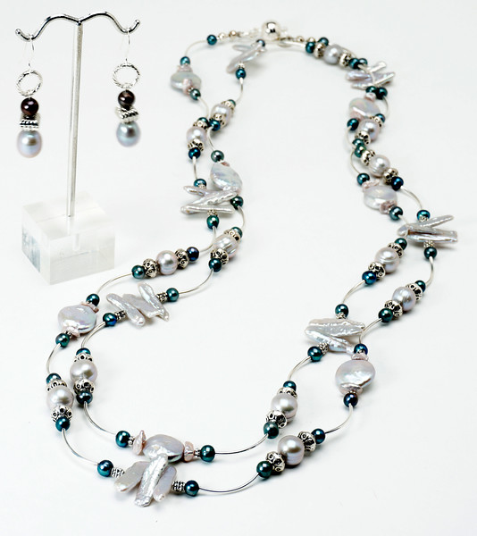 """#14117 <br>Silver and dark gray pearls <br>with pewter and silver plated tubes. Magnetic clasp. <br> Wear long at 55"""", doubled at 27"""" or tripled at 18"""" <br>Necklace Limited Edition $150.00<br>Earrings with sterling silver ear wires $31.00"""