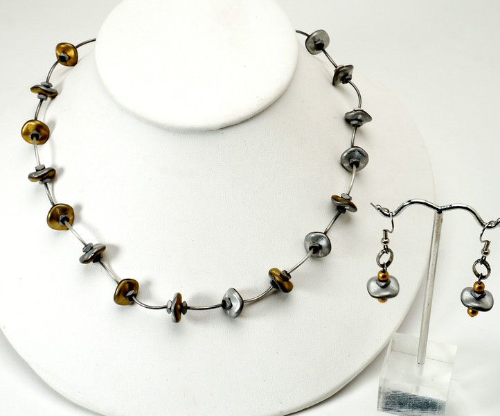 "#23816 <br>Matte gold/silver discs, steel and hematite.<br> Antiqued silver clasp and 4"" extender chain.<br>Necklace 16"" to 20"" Limited Edition $55.00<br>Earrings with surgical steel ear wires $$25.00"