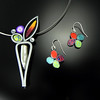 """Necklace """"Cell 16"""", polymer, pearl, sterling silver, & 18"""" stainless steel cable coated with nylon. Earring """"Cane 14"""", polymer & sterling silver."""