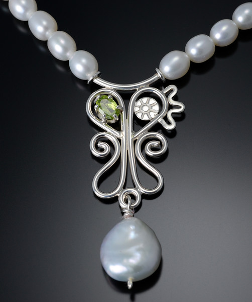 Necklace N856 with peridot and pearls. Sterling silver with 16 inch strand of pearls.  For further information, contact Smith Galleries at 1.800.272.3870.