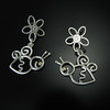 "JZHC E2SK - ""Flower & Bee Happy"" earrings E2 in sterling and 14k. To order, call Smith Galleries at 800.272.3870. Smith Galleries is located in The Village at Wexford at 1000 William Hilton Parkway in suite J11 on Hilton Head Island, South Carolina. Gallery hours are 10-6 Monday through Saturday."