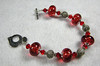"Handcrafted lampwork ""boro"" glass beads, handcrafted sterling silver marcasite beads and hancrafted sterling silver clasp, Swarovski crystals. Beautiful red! Fits a 6"" wrist. Normal price $90. SALE price $45. SOLD<br /> (ob3910)"