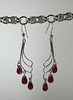 "Absolutely stunning vintage Swarovski crystals dangle from sterling silver findings. These crystals are a mottled ruby color, smooth rather than faceted. They are uncirculated, new crystals, but have not been manufactured by Swarovski for more than 60 years. These earrings dangle 2-3/4"" from the top of the stering silver earwires. Regu8lar price $60. Sale price $30. SOLD<br /> (e3817)"