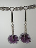 "Handcrafted lampwork glass beads, there are two wavy disks on each earring. Sterling silver chain and earwires. Purple. These earrings are 3"" long. Regular price $40. Sale price $20. SOLD<br /> (e3605)"