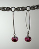 "Handcrafted lampwork glass beads, sterling silver beads. Rosy pink and white. These earrings dangle 2-1/4"" from the top of the sterling silver earwires. Regular price $25. Sale price $12.50. SOLD<br /> (e3714)"