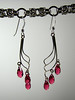 "Genuine Swarovski crystals dangle from sterling silver drops and earwires. These crystals are a new color called Indian Pink. They are 3"" long. Regular price $55. Sale price $27.50. SOLD<br /> (e3821)"