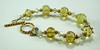 "Handcrafted lampwork glass beads, handcrafted gold vermeil beads and clasp, Swarovski crystals. Transparent sunny yellow glass. Fits a 6-3/4"" wrist. <br /> (ob3896)"