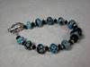 "Handcrafted lampwork glass beads, sterling silver beads and handcrafted sterling silver clasp, Swarovski crystals. Turquoise blue with black and gray. [Fits a 6-1/4"" wrist. <br /> (ob4008)"