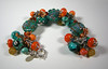 "Multi-bead charm bracelet, includes handcrafted lampork glass beads, freshwater pearls, handcrafted sterling silver beads and caps, vintage German beads, Czech glass beads, Swarovski crystals, oversize sterling silver clasp. Colors are Teal, orange, aqua. Fits a 7-8"" wrist (it is adjustable). <br /> (ob3907)"