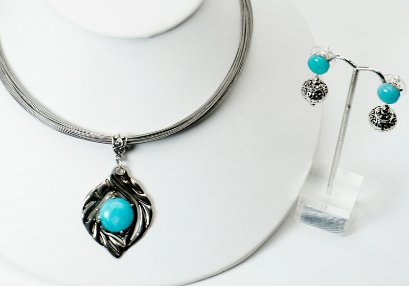 "#13317 <br>Alice Bailey Designs silver pendant <br>on multi-strand steel neck wire.<br>Silver plated clasp and 4"" built-in extender chain.<br>Necklace 16.5"" to 20.5"" Limited Edition $125.00<br>Earrings with amazonite and surgical steel posts $37.00"