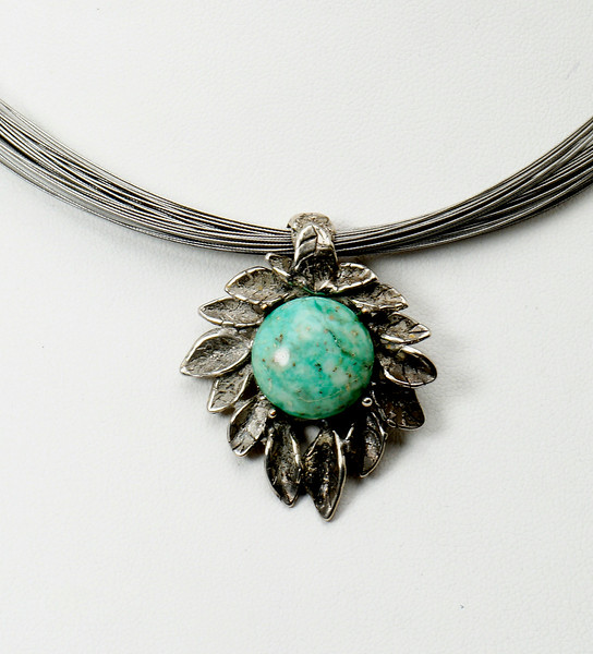 "#12917 Turquoise and antiqued silver pendant<br>on multi-strand surgical steel neck wire. <br>Silver plated clasp and 4"" extender chain. <br>16"" to 20"" One-of-a-kind. <br><br><a href=""https://www.paypal.com/cgi-bin/webscr?cmd=_cart&add=1&business=alice@AliceBaileyDesigns.com&item_name=Alice%20Bailey%20Designs%20Item%20Number%2012917%20Necklace&item_number=12897&amount=%24165.00&return=http://www.paypal.com&cancel_return=http://www.paypal.com"" target=""_click"" class=""paypalbutton"">Purchase Necklace $165.00</a><br><br>"