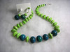 "Large blue/green (teal) azurite beads coupled with genuine turquoise beads, a few genuine Swarovski crystals, and sterling silver. About 20"" long. The matching earrings are 1-3/4"" long.<br /> (op4145)"
