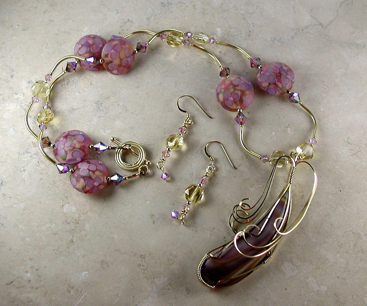 """SOLD<br /> <br /> Gemstone: """"Wonderstone"""" wire-wrapped in gold-filled wire.<br /> Handcrafted lampwork glass beads, faceted citrine, Swarovski crystals, gold-filled beads and clasp"""