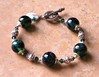 "Handcrafted lampwork glass beads, genuine Swarovski crystals, handcrafted sterling silver beads and toggle clasp. This bracelet will fit a 7-1/2"" wrist. <br /> (ob3844)"