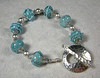 "Handcrafted lampwork glass beads, genuine Swarovski crystals, sterling silver beads and handcrafted toggle clasp. This bracelet will fit a 6-1/2"" wrist. <br /> (ob4013)"