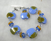"Handcrafted lampwork glass beads, genuine Swarovski crystals, glass ""donut"" beads, sterling silver beads and toggle clasp. This bracelet will fit a 7-1/4"" wrist. <br /> (ob4094)"