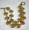 "Handcrafted lampwork glass beads, genuine Swarovski crystals, 22K gold vermeil and gold-filled beads and toggle clasp. Fits a 6-3/4"" wrist. (ob4018)"