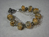 "Handcrafted lampwork glass beads, genuine Swarovski crystals, sterling silver beads, chain, and toggle clasp. Fits a 5"" wrist. <br /> (ob4017)"