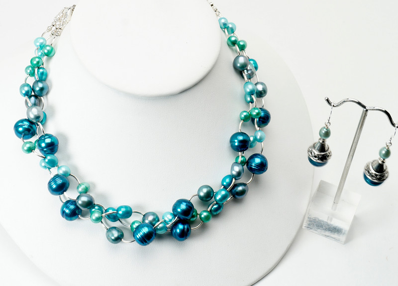 """#10817AN Convertible color-treated pearls and silver plated tubes.<br> Silver plated clasp and 4"""" built-in extender chain. <br> Wear one, two or three strands <br>OR hook strands together for long necklace. <br>Necklace 16"""" to 20"""" Limited Edition. $175.00 <br>Earrings with silver ear wires $29.00"""