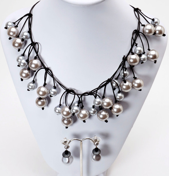 "#21916 <br>Silver glass pearls on matte black leather.<br>Gunmetal clasp and 4"" extender chain. <br>Necklace 16"" to 20"" Limited Edition. <br> Earrings with surgical steel posts $25.00<br>Lightweight!"
