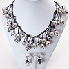 """#21916 <br>Silver glass pearls on matte black leather.<br>Gunmetal clasp and 4"""" extender chain. <br>Necklace 16"""" to 20"""" Limited Edition. <br> Earrings not available<br>Lightweight!"""