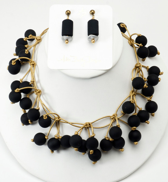 "#20816 <br>Black rubber and gold metallic leather. <br>Gold plated clasp and matte gold 4"" extender chain.<br> Necklace 16"" to 20"" Limited Edition $150.00<br>Earrings with gold plated posts $26.00<br>Super lightweight!"
