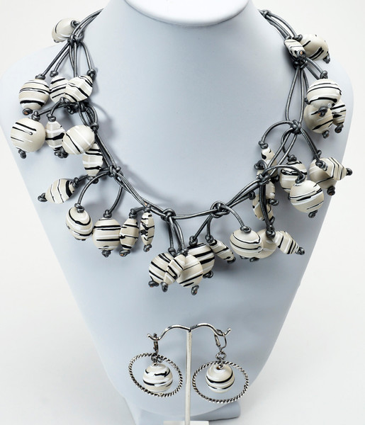 "#21416 <br>White-Gray-black acrylic rubber and metallic silver leather. <br>Antiqued silver clasp and 4"" extender chain. <br>Necklace 16"" to 20"" Limited Edition $150.00<br>Earrings with gunmetal French clips $29.00<br>Very lightweight!"