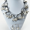 """#21416 <br>White-Gray-black acrylic rubber and metallic silver leather. <br>Antiqued silver clasp and 4"""" extender chain. <br>Necklace 16"""" to 20"""" Limited Edition $150.00<br>Earrings with gunmetal French clips $29.00<br>Very lightweight!"""