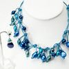 """#16217<br>Color-treated pearls <br>On turquoise leather.<br>Silver plated clasp <br>And 4"""" extender chain.<br>Necklace 16"""" to 20"""" One-of-a-kind. $195.00<br> Earrings with silver plated posts $39.00<br> Extremely lightweight!"""