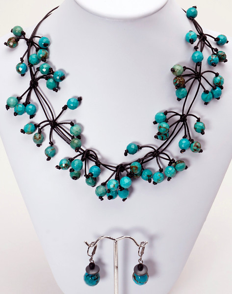 """#20916 Faceted turquoise and black leather. <br>Gunmetal clasp and 4"""" extender chain. <br>16"""" to 20"""" Limited Edition.<br><br><a href=""""https://www.paypal.com/cgi-bin/webscr?cmd=_cart&amp;add=1&amp;business=alice@AliceBaileyDesigns.com&amp;item_name=Alice%20Bailey%20Designs%20Item%20Number%20916%20Necklace&amp;item_number=20916&amp;amount=%24195.00&amp;return=http://www.paypal.com&amp;cancel_return=http://www.paypal.com"""" target=""""_click"""" class=""""paypalbutton"""">Purchase Necklace $195.00</a><br><br> <br><br><a href=""""https://www.paypal.com/cgi-bin/webscr?cmd=_cart&amp;add=1&amp;business=alice@AliceBaileyDesigns.com&amp;item_name=Alice%20Bailey%20Designs%20Item%20Number%2020916%20Earrings&amp;item_number=20916&amp;amount=%2428.00&amp;return=http://www.paypal.com&amp;cancel_return=http://www.paypal.com"""" target=""""_click"""" class=""""paypalbutton"""">Purchase Earrings $28.00</a><br><br> <br><br><a href=""""https://www.paypal.com/cgi-bin/webscr?cmd=_cart&amp;add=1&amp;business=alice@AliceBaileyDesigns.com&amp;item_name=Alice%20Bailey%20Designs%20Item%20Number%2020916%20Earrings%20and%20Necklace&amp;item_number=20916&amp;amount=%24223.00&amp;return=http://www.paypal.com&amp;cancel_return=http://www.paypal.com"""" target=""""_click"""" class=""""paypalbutton"""">Purchase Necklace and  Earrings $223.00</a><br><br> <br><br><br><br><img src=""""http://ali.smugmug.com/Other/WebSiteImages/i-BftLFq2/0/O/paypal-175-50-O.jpg""""><br><font class=""""captionfooter"""">Free Shipment on all Orders</font>"""