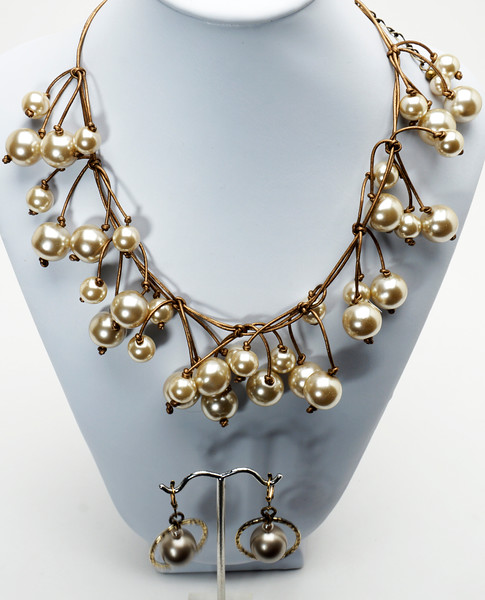 "#21716<br> Champagne glass pearls on metallic brown leather. <br>Antiqued bronze clasp and 4"" extender chain. <br>Necklace 16"" to 20"" Limited Edition $150.00<br>Earrings with antiqued bronze French clips $32.00<br> Lightweight!"