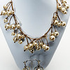 """#21716<br> Champagne glass pearls on metallic brown leather. <br>Antiqued bronze clasp and 4"""" extender chain. <br>Necklace 16"""" to 20"""" Limited Edition $150.00<br>Earrings with antiqued bronze French clips $32.00<br> Lightweight!"""