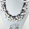 "#18016 <br>Natual white pearls on matte black leather.<br> Matte black clasp and 4"" extender chain. <br>Necklace 16.5"" to 20"" Limited Edition $199.00<br>Earrings with gunmetal French clips $29.00"
