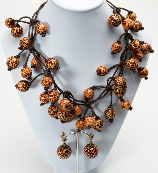 "#17816 <br>Leopard wood and brown leather. <br>Silver plated clasp and 4"" extender chain. <br>Necklace 16.5"" to 20"" Limited Edition $150.00<br>Earrings with antiqued bronze posts $25.00<br> Ultra lightweight!"