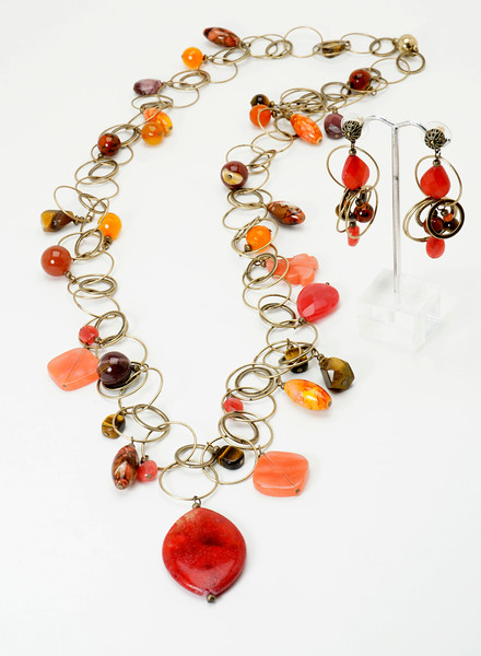 "#14819<br>Fantasy jade, carnelian, tiger's eye<br>Mookite jasper, strawberry quartz and porcelain<br>On multi-loop antiqued bronze chain.<br>Wear long @37"" or doubled @18""<br>Limited Edition.Necklace $225.00 <br>Earrings $40.00"