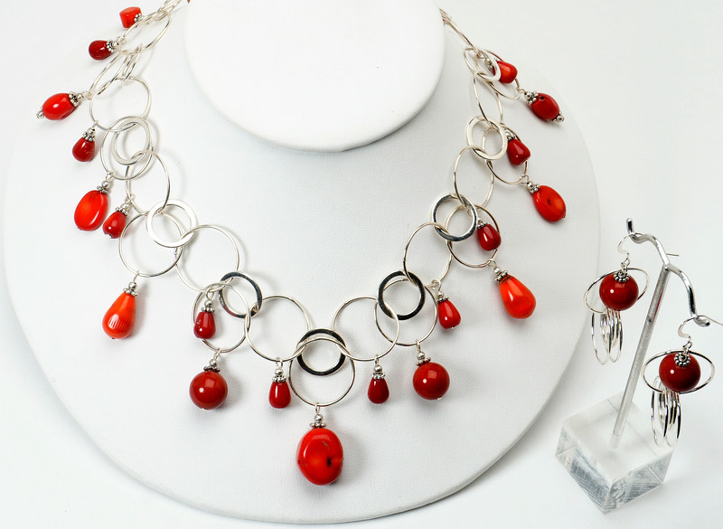 "#15714<br>Red coral and pewter<br>on silver plated multi-loop chain<br>Silver plated clasp<br>and 4"" built-in extender chain.<br>Necklace 16"" to 20"" Limited Edition. $135.00<br> Earrings with sterling silver ear wires $37.00"