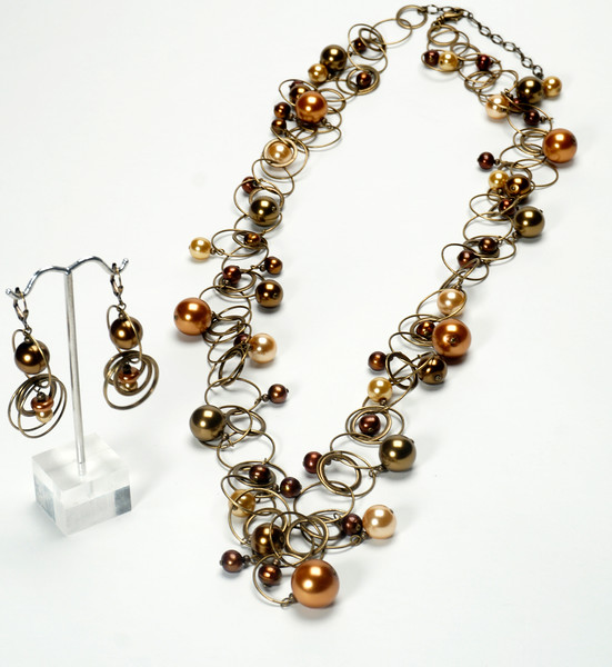 """#12920<br>Swarovski and glass pearls<br>On antiqued bronze chain, clasp and 4"""" extender chain. <br>Wear long (as shown) at 38"""" or doubled at 18"""""""". Limited Edition.<br>Necklace $275.00<br>Earrings $36.00"""