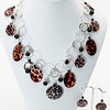 """#18719<br>Leopard print shell drops<br>On silver plated chain, clasp<br>And 4"""" extender chain.<br>16"""" to 20"""" Limited Edition. <br>$150.00 Earrings $25.00"""