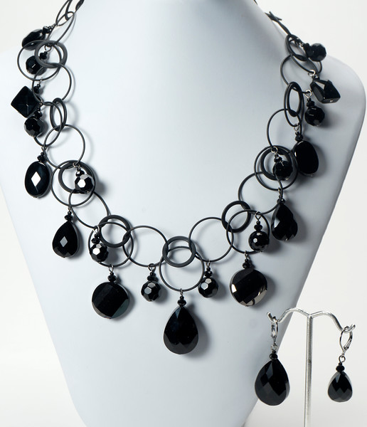 """#14520<br>Black onyx and glass<br>On Nite black chain, clasp and 4"""" extender chain.<br>17"""" to 21"""" Limited Edition.<br>Necklace $150.00<br>Earrings """"A""""on left $28.00 Earrings """"B"""" on right $27.00"""