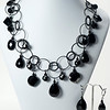 "#14520<br>Black onyx and glass<br>On Nite black chain, clasp and 4"" extender chain.<br>17"" to 21"" Limited Edition.<br>Necklace $150.00<br>Earrings ""A""on left $28.00 Earrings ""B"" on right $27.00"