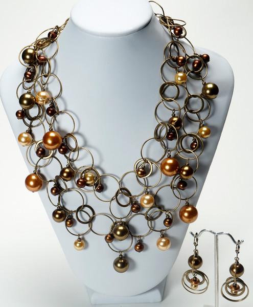 """#12920<br>Swarovski and glass pearls<br>On antiqued bronze chain, clasp and 4"""" extender chain. <br>Wear doubled (as shown) at 18"""" or long at 38"""". Limited Edition.<br>Necklace $275.00<br>Earrings $36.00"""