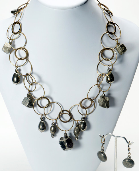 "#13220<br>Pyrite on antiqued bronze chain, <br>Clasp and 4"" extender chain.<br>17"" to 21"" Limited Edition.<br>Necklace $150.00<br>Earrings $29.00"