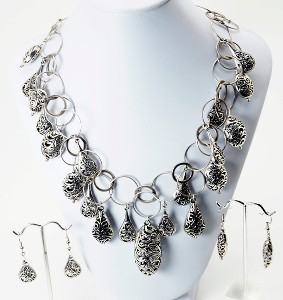 """#12819<br>Pewter on antiqued silver chain.<br>Antiqued silver clasp and 4"""" extender chain.<br>17"""" to 21"""" Limited Edition.<br>Necklace $125.00<br>Earrings on left $26.00<br> Earrings on right $26.00"""