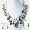 """#12819<br>Pewter on antiqued silver chain.<br>Antiqued silver clasp and 4"""" extender chain.<br>17"""" to 21"""" Limited Edition.<br>Necklace $150.00<br>Earrings on left $26.00<br> Earrings on right $26.00"""